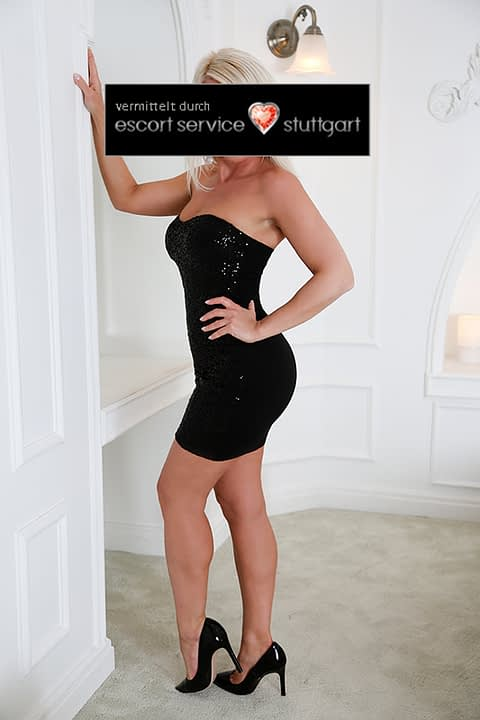 Escort Luna posing in a black dress