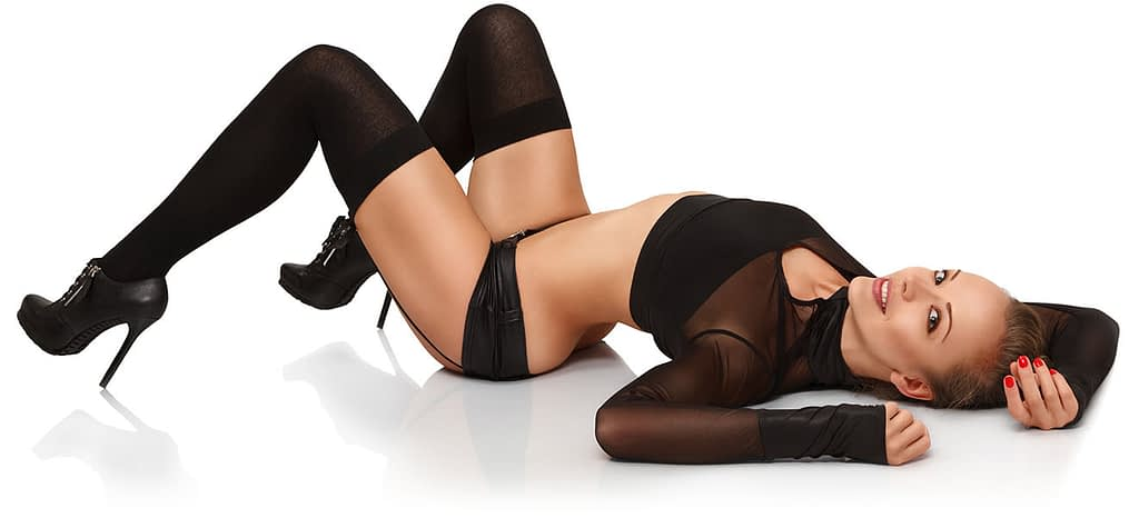Sexy model wearing black outfit laying on her back